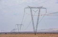 High voltage lines and power pylons.  royalty free stock images