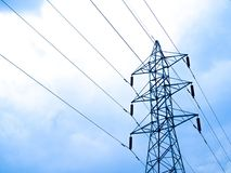 High voltage lines and power pylons Stock Photography