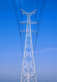 High voltage lines and power pylons Stock Photo