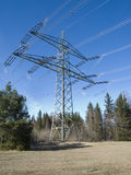 High voltage mast on a forest Glade Stock Photos