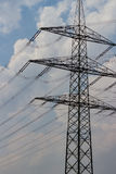 High voltage mast before sky. High voltage mast before cloudy sky Royalty Free Stock Images