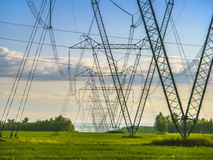 High-voltage masts in the field Stock Images