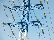 High voltage metal transmission tower is close. High voltage metal transmission with wires is close stock image