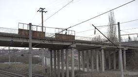 High-voltage network, isolators, bridge, road in the Ukrainian village. 4K stock footage