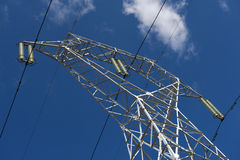 High voltage pole. Over blue sky Stock Photo