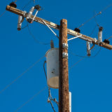 High Voltage Pole. High voltage post against blue sky Royalty Free Stock Image