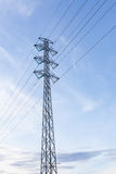 High voltage pole against blue sky Stock Photography