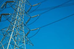 High voltage pole on bluesky background, Energy supply by power. Line Royalty Free Stock Photo