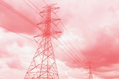 High voltage pole on a day the sky is very cloudy royalty free stock photo