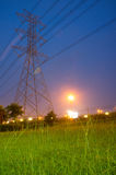 High voltage pole and grass. Background picture Stock Photo