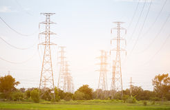 High voltage pole. Located in the field Stock Photo