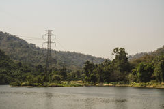 High voltage pole on the nature. And water resources Stock Photography