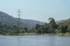High voltage pole on the nature. And water resources Stock Image
