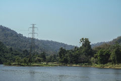 High voltage pole on the nature. And water resources Stock Photos