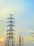 High voltage poles. With beautiful sky in sunset Royalty Free Stock Photo