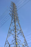 high voltage tower pole and transmission electrical power lines with red and white ball for aircraft warning Stock Images