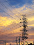 High voltage poles silhouette. With beautiful sky in sunset Stock Images