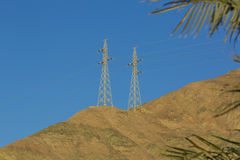 High-voltage poles with wires. In the mountains Royalty Free Stock Photos