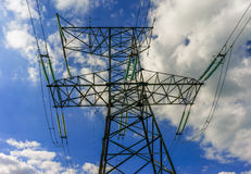 High voltage post against clear blue sky. High voltage post against clear blue sky Royalty Free Stock Photography