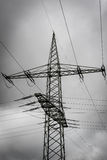 High voltage post. Against dramatic sky Royalty Free Stock Image