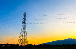High voltage post,Electricity pylons and lines at sunset. Stock Images
