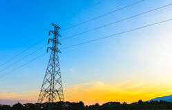 High voltage post,Electricity pylons and lines at sunset. Royalty Free Stock Images