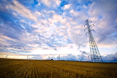 High voltage post with field and sky. Royalty Free Stock Photography