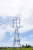 High voltage post in green field Royalty Free Stock Photos