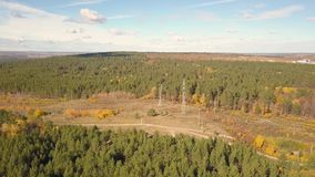 High voltage post. In forest, Electric tower with wires in nature aerial video stock footage