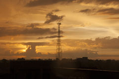 High voltage post. High-voltage tower sunset background. Royalty Free Stock Images