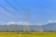 High voltage post and power lines with blue sky Stock Images