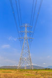 High voltage post and power lines with blue sky Royalty Free Stock Images
