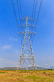 High voltage post and power lines with blue sky Stock Image