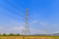 High voltage post and power lines with blue sky Stock Photo