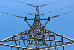 High voltage post or power transmission line tower on blue sky Stock Photo