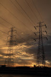 High voltage post sky background. Royalty Free Stock Image
