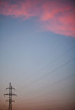 High voltage post at sunset. Royalty Free Stock Photo