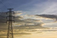 High voltage post at sunset Stock Photography