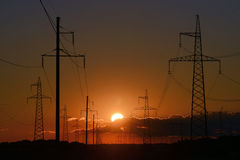 High voltage post at sunset Royalty Free Stock Photos
