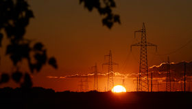 High voltage post at sunset Royalty Free Stock Image