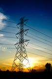 High voltage post. High-voltage tower on twilight background Royalty Free Stock Images