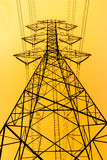 High Voltage Post on yellow background Royalty Free Stock Photo