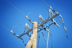 High voltage power divider. On a blue sky background Royalty Free Stock Photo