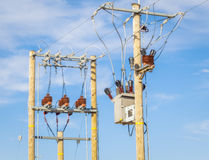 High voltage power divider and transformer on blue sky Stock Photos