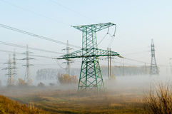 High-voltage power line against the autumn landscape Royalty Free Stock Images