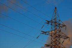 High-voltage power line against the background of the sky Stock Photo