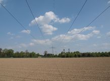 High voltage power line against blue sky Royalty Free Stock Image