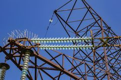 High-voltage power line against the blue sky with clouds royalty free stock photo