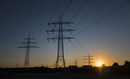 High voltage power line against blue sky. At dawn Stock Photo