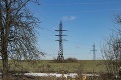 High-voltage power line against a blue sky royalty free stock photos